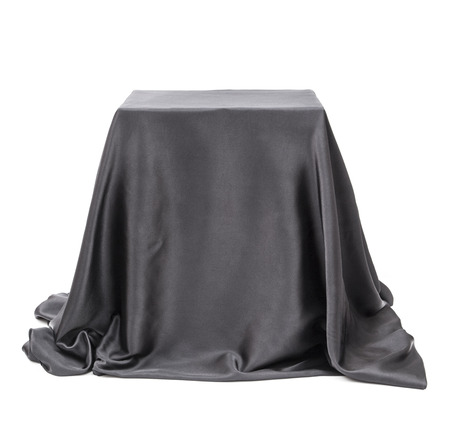 unveil: Box covered with black cloth.