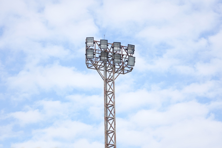 lamp light: Sport lights with cloudy sky. Stock Photo