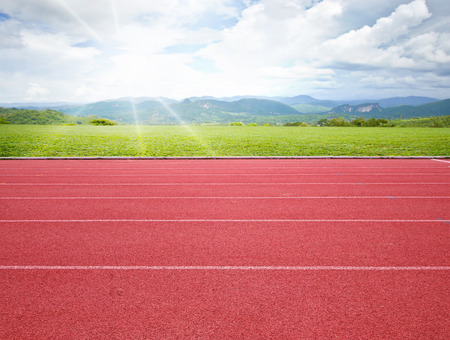 running track with green grass background