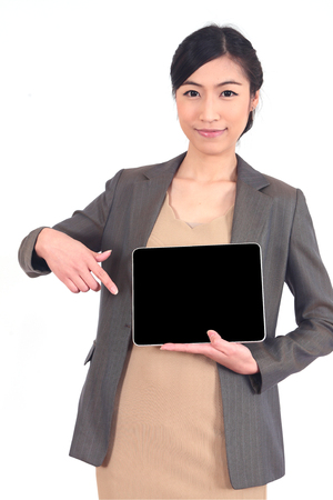 notebook computer: smiling young beautiful business woman holding a tablet.