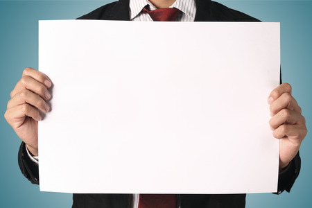 business man showing blank signboard,