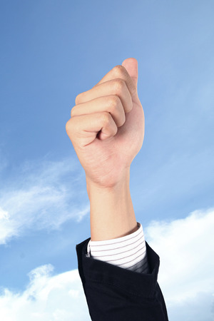 whit: business man hand whit victory signal on sky Stock Photo