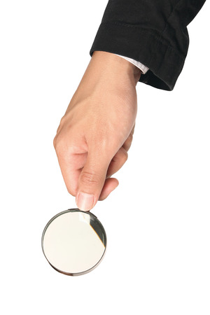 Brass Magnifying glass in business hand isolated over white background