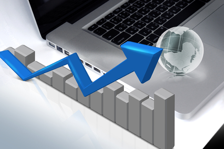 financial world: blue arrow graph on desktop
