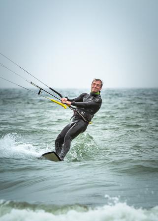kitesurfer standing on board Stock Photo