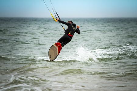 kitesurfer jumping waves