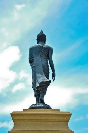 veneration: Walking Buddha statue