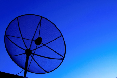 Satellite dish in blue sky Stock Photo - 11694791