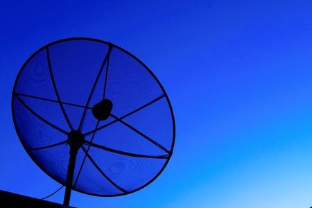Satellite dish in blue sky Stock Photo - 11694791