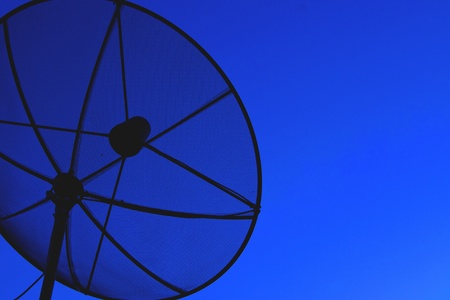 Satellite dish in blue sky