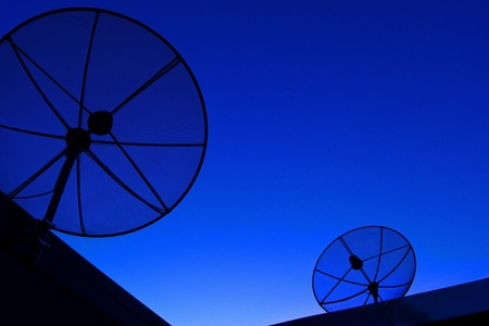 Satellite dish in blue sky Stock Photo - 11694788