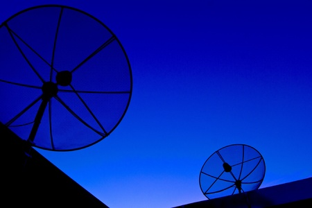 Satellite dish in blue sky Stock Photo - 11694789