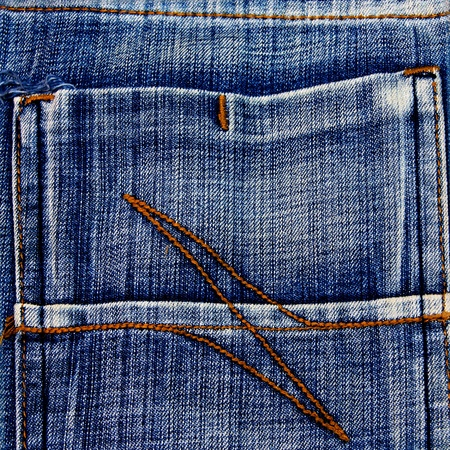 Fragment of jeans texture photo