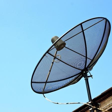 Satellite dish in blue sky Stock Photo - 11694827