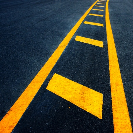 yellow dividing lines on the highway  Stock Photo