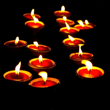 condolence: candles on black background  Stock Photo
