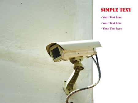 Security camera on wall of building Stock Photo