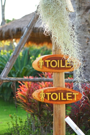 Toilet direction board in the garden  photo