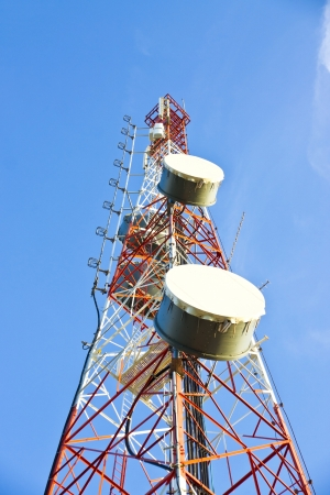Telecommunication tower with antennas a blue sky  photo