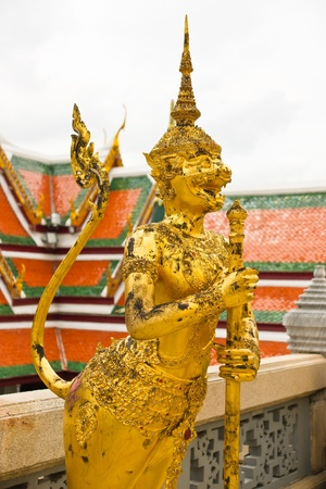 Golden Angel with Pagoda Wat Phra Kaeo, Thailand photo
