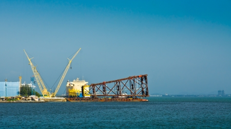 cranes are waiting for cargo on port boat photo