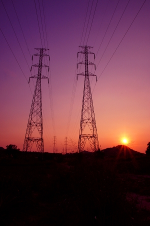 isolator high voltage: Electricity pylons on sunset