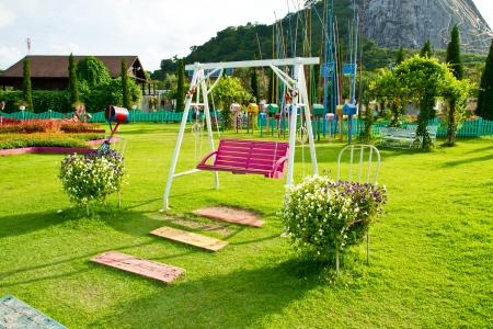 wood swing chair in the garden green