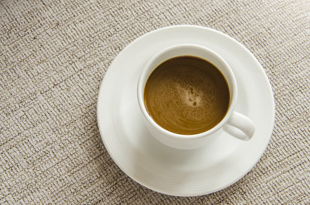 coffee cup on table background