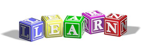 Bloques de letra del alfabeto formando la palabra aprender