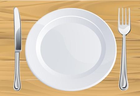Lege plaat en mes en vork bestek couvert op rustieke houten tafel