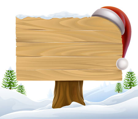 A Christmas wooden sign with a Santa Hat hanging on it in a winter scene with trees in the background