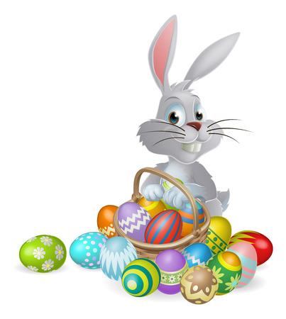 Un coniglio bianco Coniglietto di Pasqua con un cesto di uova di Pasqua di cioccolato dipinte Archivio Fotografico - 25382587