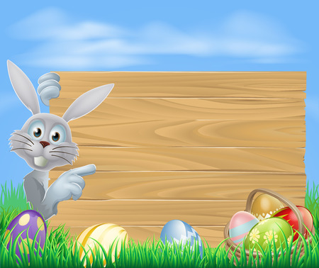 Easter bunny pointing at a wooden sign, with chocolate painted Easter eggs and basket
