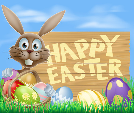 Easter bunny pointing at a wooden sign with Happy Easter message, with chocolate painted Easter eggs and basket