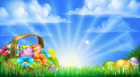 Easter scene. Basket full of decorated chocolate Easter eggs and flowers in a field
