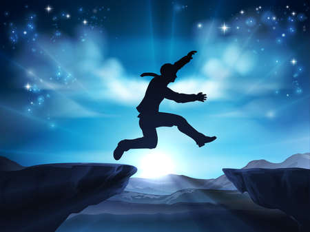 Businessman in silhouette in mid air jumping across a mountain gap. A concept for taking a leap of faith, being courageous or taking a risk in business or ones career.