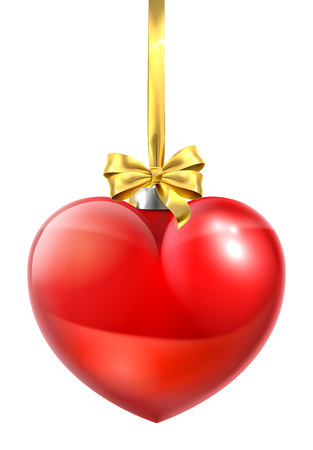A heart shaped Christmas ball bauble ornament with a gold bow and ribbon