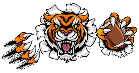 A Tiger angry animal sports mascot holding an American football ball and breaking through the background with its claws