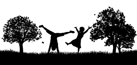 Little kids or children playing in the park or exercising outdoors in silhouette