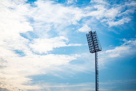 stadium lights with blue sky background Imagens