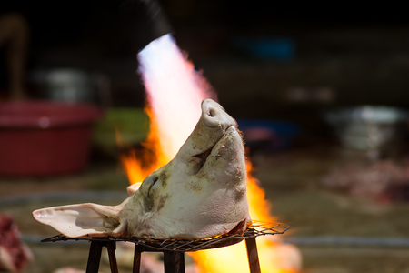 Burning pork head before cleaning in a rural area Stock Photo