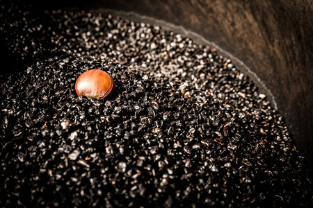 chiness: Chiness roasted chestnuts in gravel oven Stock Photo