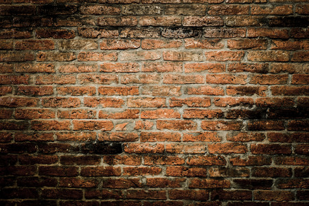 vignetted: red brick wall texture grunge background with vignetted corners Stock Photo