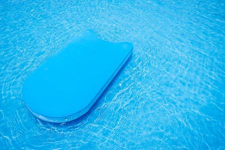 flotation: pool kick board in swimming pool Stock Photo