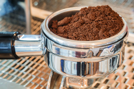 grounded: Coffee portafilter filled with finely grounded coffee