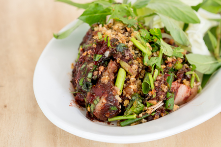 excrete: Raw pork spicy minced meat salad, Northern Thailand local food.