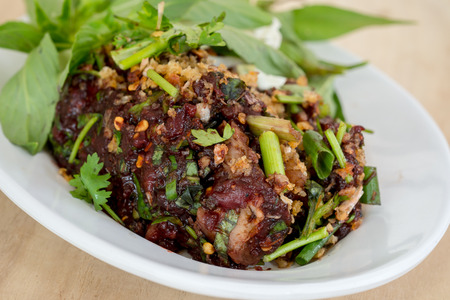 defecate: Raw pork spicy minced meat salad, Northern Thailand local food.