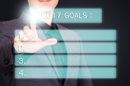 Businessman pointing or touching on virtual 2017 goals screen Reklamní fotografie