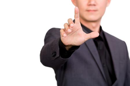 Obchodník směřující nebo dotykem na bílém pozadí