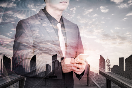 double exposure of businessman with technology social network background.